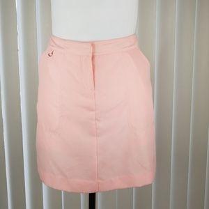IZOD ▪ XFG Golf skort in baby pink w/ 3 pockets